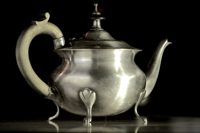 Silver teapot with wooden handle